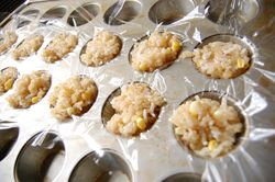 Rice in plastic wrap-lined muffin pan