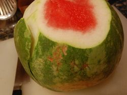 Cut the watermelon skin