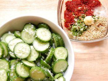 2) Salt cucumbers, wash then mix seasoning