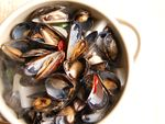 Steamed Mussels (홍합찜) in Spicy Radish Broth & Buckwheat Noodle Soup