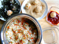 4) Set up the rice ball station - nori, sesame seeds, spicy sauce, water and seasoned rice mixed with vegetables.