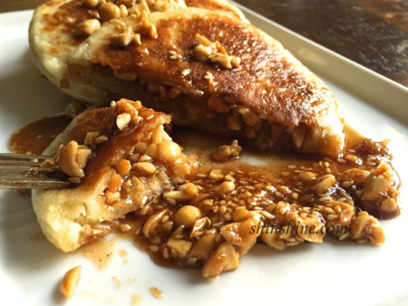 Hotteok filled and drizzled over with cinnamon peanut syrup