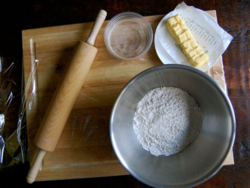 Line a flat surface with plastic wrap & prepare pie crust dough ingredients.