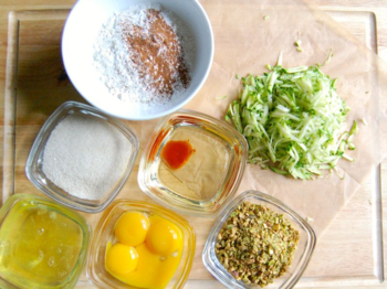 Get ingredients ready - egg whites, sugar, egg yolks, oil & vanilla extract, zucchini, pistachio and mix of dry ingredients.